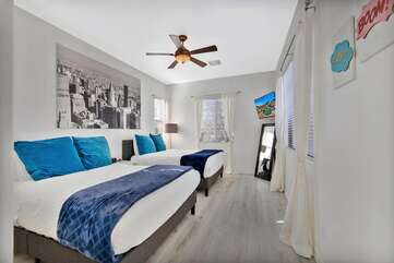Bedroom 3 has 2 Queen beds and a large HDVT