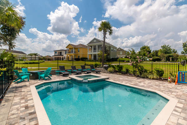 Soak up the Florida sun in the private pool with spillover spa