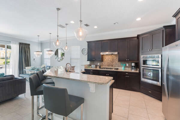 Enjoy the open living space from the spacious kitchen area