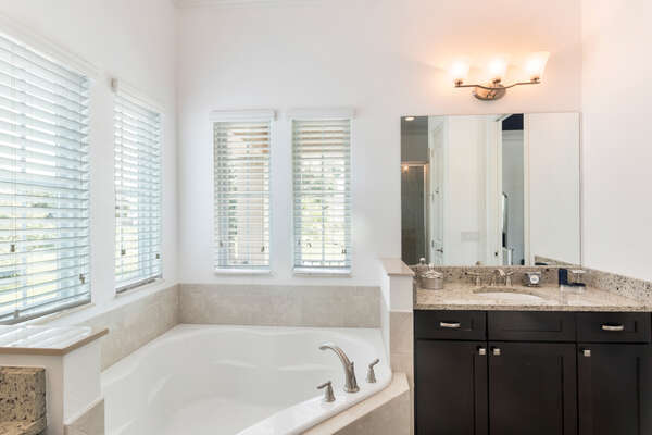 Two sinks and a luxurious tub to soak in