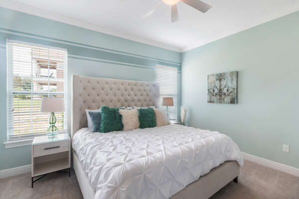 The downstairs Master Suite features a comfortable King sized bed and luxurious details