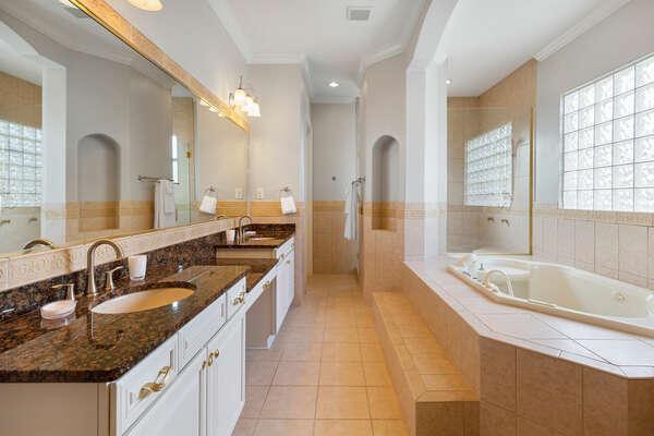 The ensuite master bathroom features a luxurious garden bathtub
