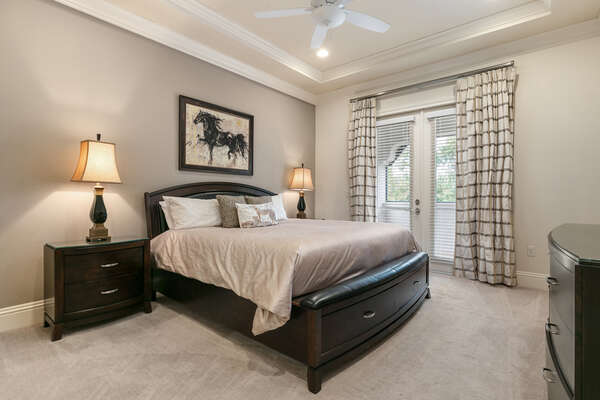 Master suite with king size bed, access to balcony, and en-suite bathroom