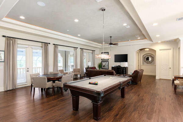 The second floor loft area features pool and poker table