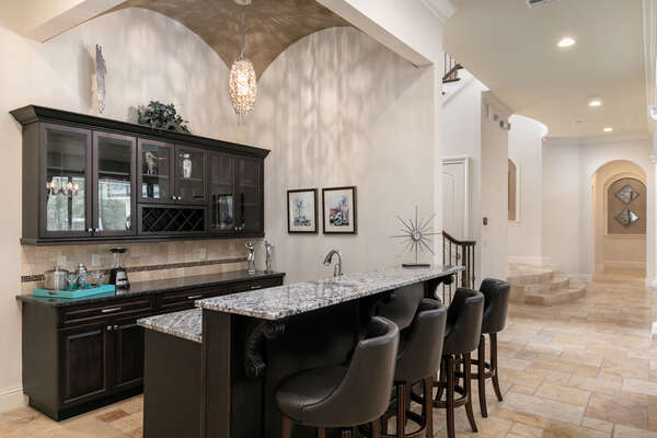 The area also features a fully equipped wet bar