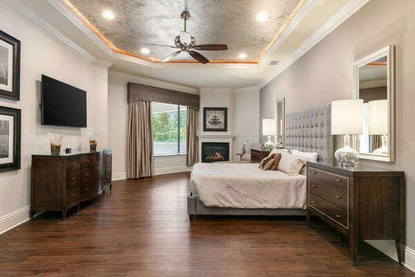 The second floor master suite features a king-size bed, SMART TV, en-suite bathroom (Disclaimer: Fireplace(s) not allowed for guest use, homeowner use only.)