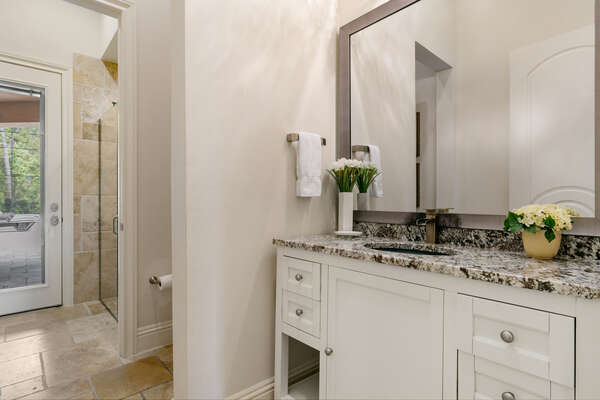 The en-suite bathroom features a walk-in shower