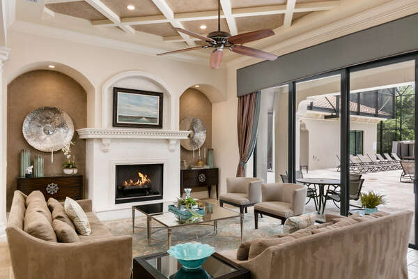 Gather round this luxurious living room with comfortable seating (Disclaimer: Fireplace(s) not allowed for guest use, homeowner use only.)