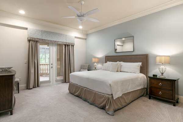 Master suite features king size bed, access to balcony, en-suite bathroom, and SMART TV