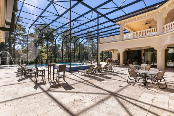 The whole family will love to spend time together poolside with plenty of seating in this screened-in porch