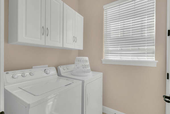 The laundry room with full size washer and dryer