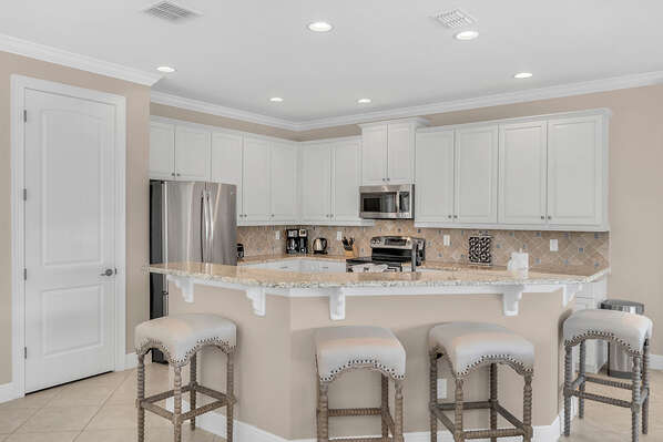 A fun breakfast bar for 4 and a fully equipped kitchen