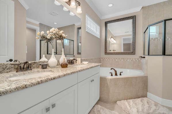 The beautiful ensuite master bathroom with Italian decor