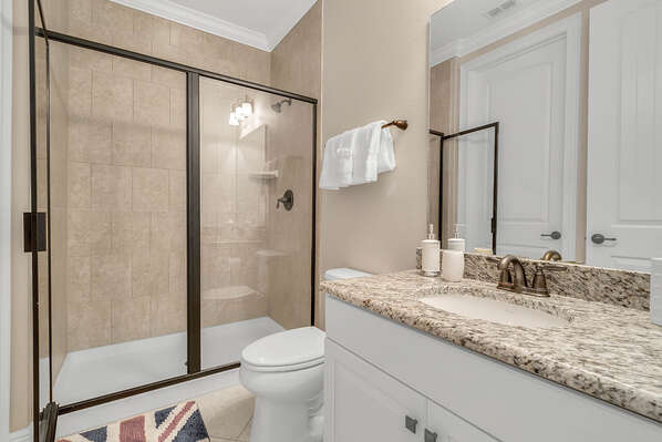 The ensuite bathroom has a walk in shower and plenty of room to get ready