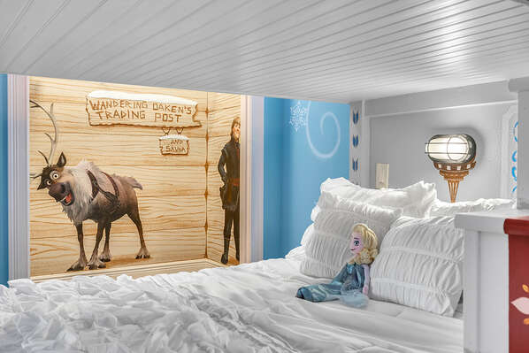 The bottom bunk features a full size bed and top bunk is a twin