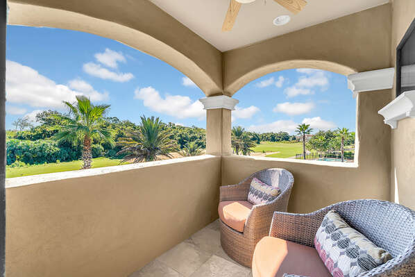 The second floor balcony features amazing views and comfortable patio furniture