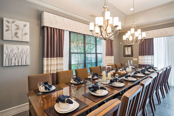 Enjoy family dinners in the dining table with seating for 16