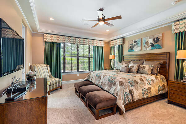Master Suite 1 is located on the ground floor with a 50-inch TV and DVD Player