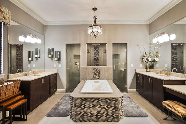 The master en-suite bathroom features a walk-in shower and jetted tub to relax