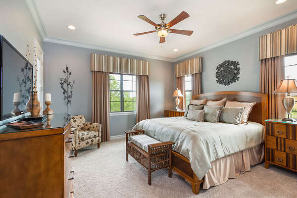 Master Suite 2 features a 50-inch TV and balcony access all located on the second floor