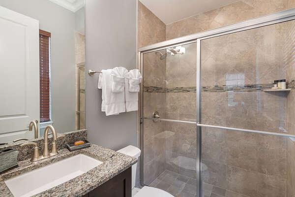 The master en-suite bathroom features a glass door walk-in shower