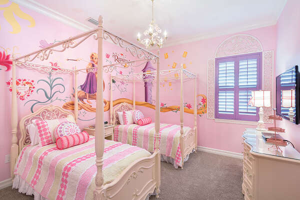 The princesses will love their custom bedroom with two twin beds