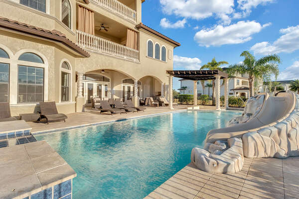 This luxurious 12-bedroom villa features incredible amenities for your next Orlando vacation