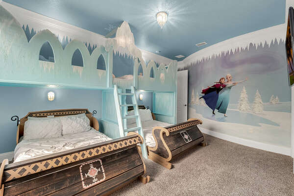Head upstairs to this icy princess room complete with two full beds and two twin beds