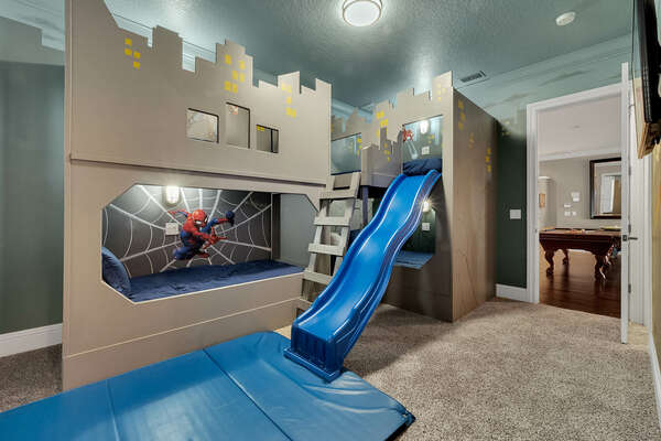 Superheroes can slide all day in their bedroom with two full beds and two twin beds