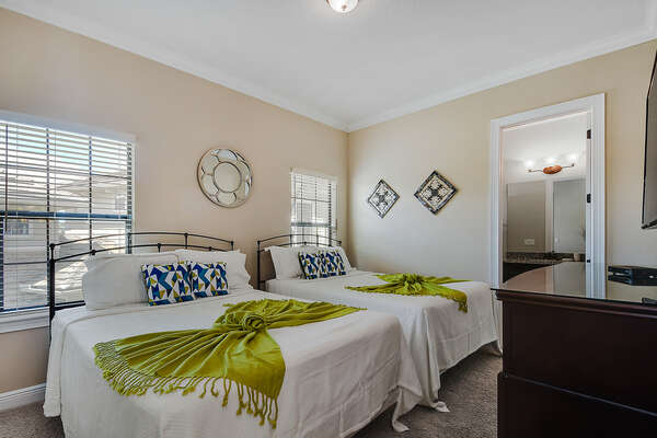 Two full beds in this luxurious upstairs bedroom
