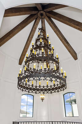 The custom Renaissance-inspired chandelier hangs beautifully from the 35-foot high celling