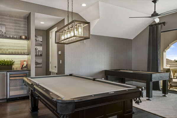Both a billiards and shuffleboard table are located in the third floor lounge
