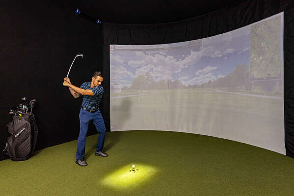 This High-Tech Sports Simulator Room features a SwingTrack Elite simulator with 87 PGA Golf Courses and 13 Sports Games