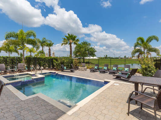 The pool area features multiple seating areas , 8 sun loungers, and 2 rockers around the fire pit