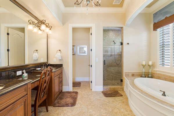 The en-suite bathroom features a glass door walk-in shower