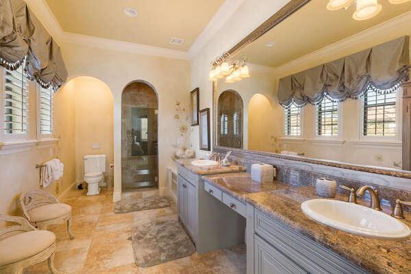 The en-suite bathroom has dual vanity and glass door walk-in shower
