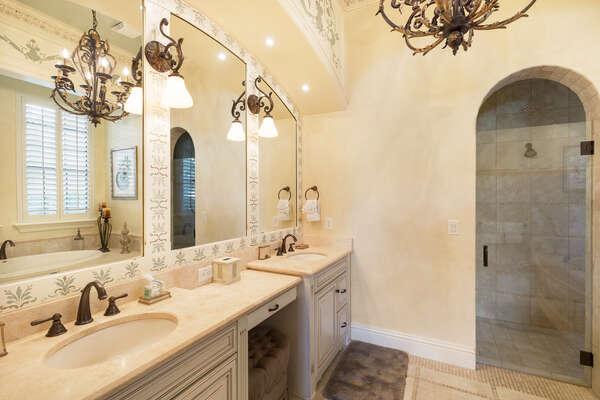 En-suite bathroom with dual vanity and glass walk-in shower