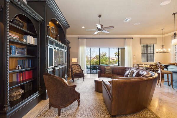 The living area features a 65-inch 4K 9 Series SMART TV and leather furnishing