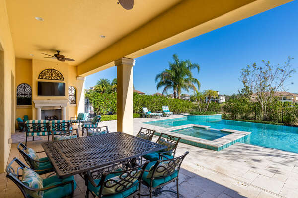 The covered lanai features luxury patio furniture (Disclaimer: Fireplace(s) not allowed for guest use, homeowner use only.)