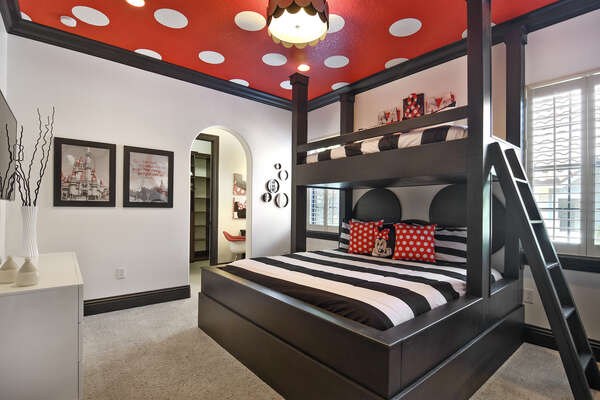 An amazing themed kids suite with custom built bunk beds