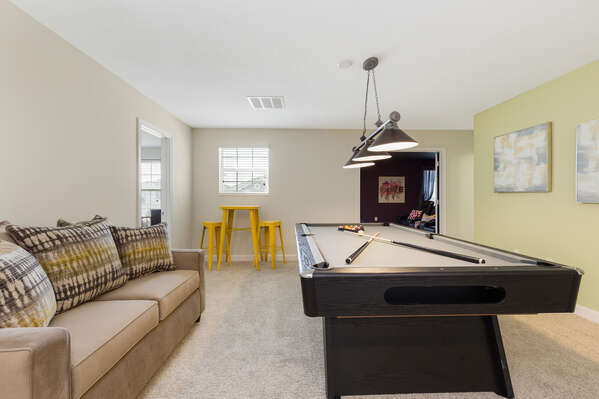 The second floor loft game room features a pool table
