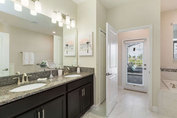 The ensuite master bathroom has access to the pool deck