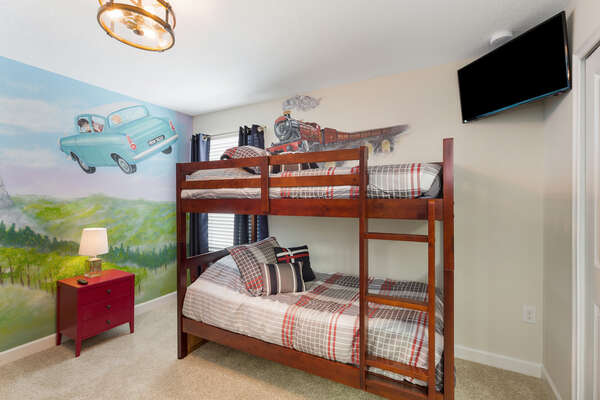 This bedroom features twin/twin bunk beds and will make you feel like a part of the magic