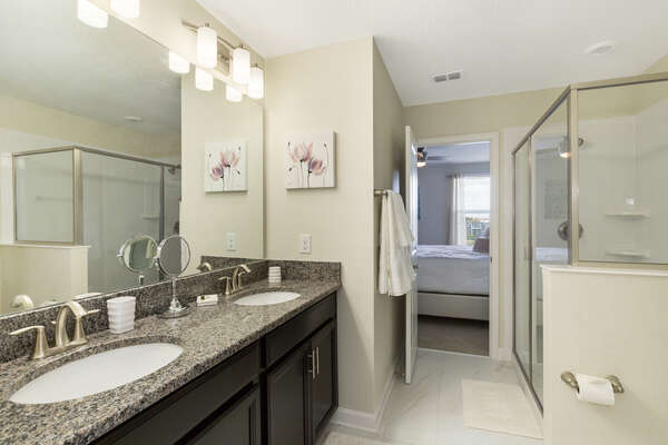 This jack and jill style bathroom is shared between two King bedrooms