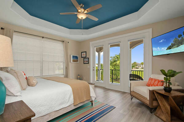 The master suite features a king size bed, en-suite bathroom, and access to the patio balcony