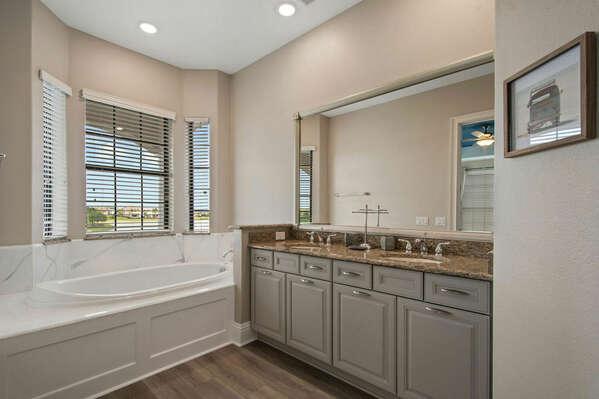 The master en-suite bathroom features dual vanity, garden tub, and walk-in shower