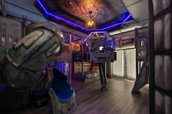 Kids will travel out of this world in the galactic themed room