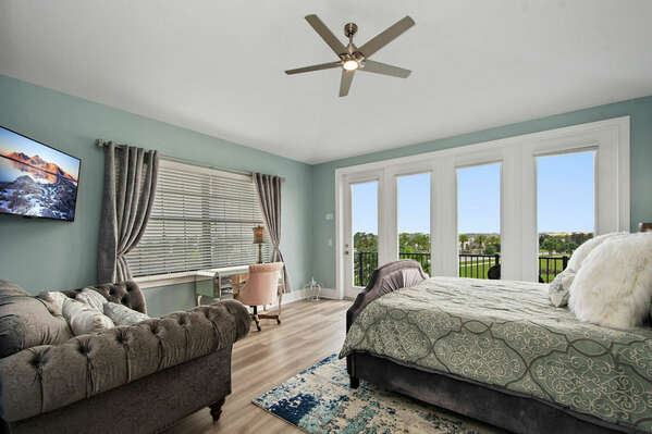 This master suite features a king bed, en-suite bathroom, and access to patio balcony