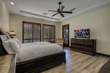 Master bedroom has its own separate access to backyard pool area