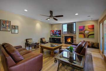 The family room features an HDTV, fireplace and french doors leading to a courtyard patio seating area.